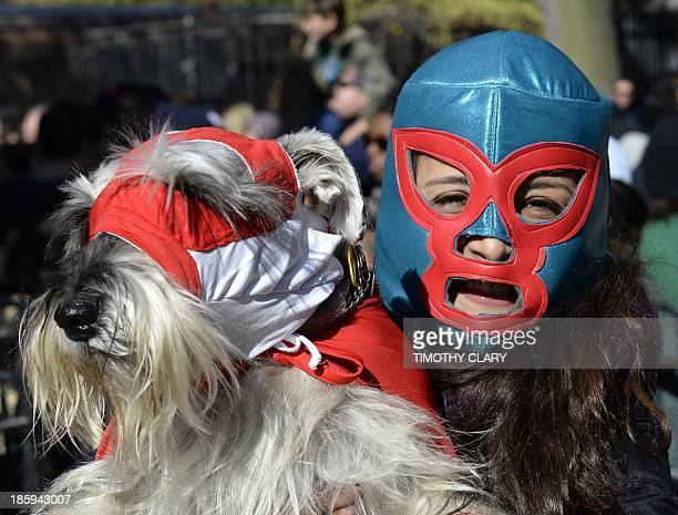 Woman and her dog dressed as wrestlers participate in the 23rd Annual Tompkins Square Halloween Dog Parade on October 26, 2013 in New York City....