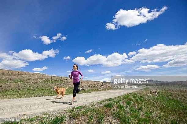 A woman and her dog jogging.