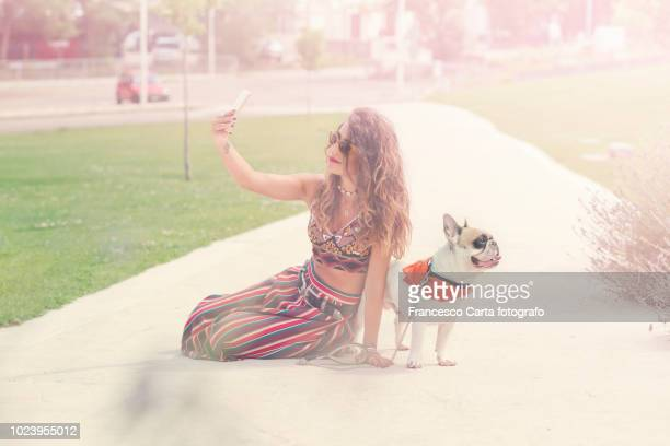 woman and her dog - tempio pausania stock pictures, royalty-free photos & images