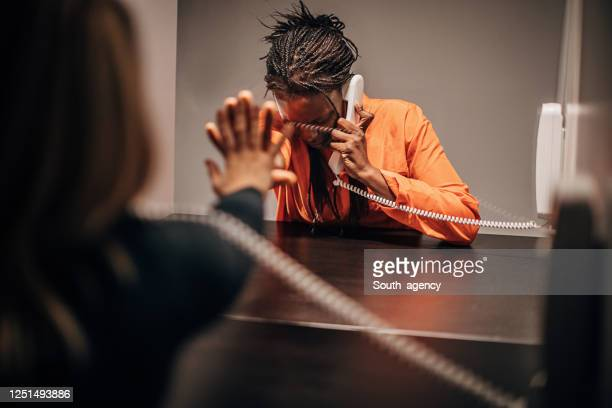 woman and her girlfriend in visiting room - prisoner stock pictures, royalty-free photos & images