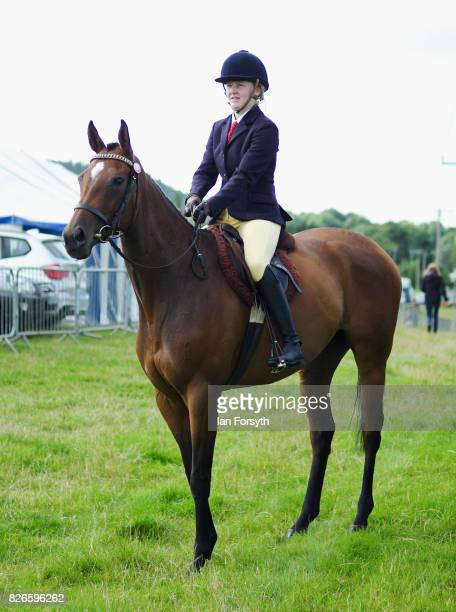 Woman and her horse wait to enter the main show arena during the Osmotherley Country Show on August 5, 2017 in Osmotherley, England. The annual show...