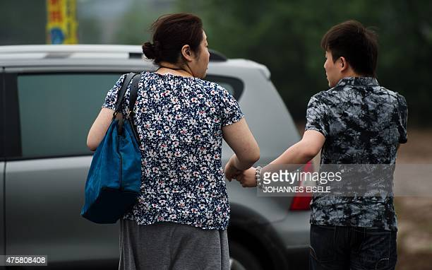 A woman and her husband who's father was on the capsized passenger ship carrying more than 450 people which sunk in the Yangtze river triggering a...