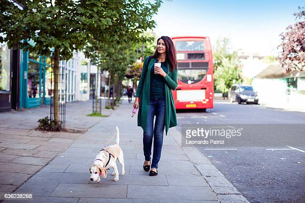 Woman and her own dog in early Sunday morning