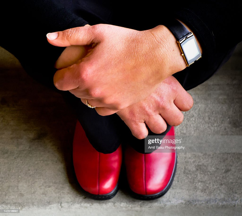 Woman and her red shoes : Stock Photo