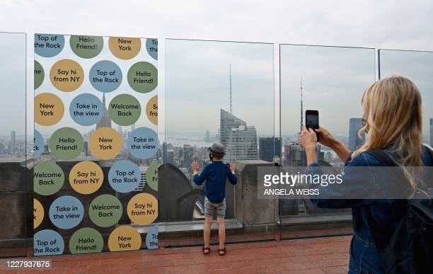 Woman and her son take pictures during the reopening of the Top of The Rock observation deck on August 6, 2020 in New York City. - The Top of the...