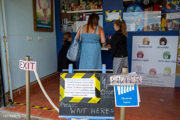 A woman and her two daughters get icecream from the Sunny Sands Kiosk on the 7th of July 2020 in Folkestone United Kingdom Non essential retails...
