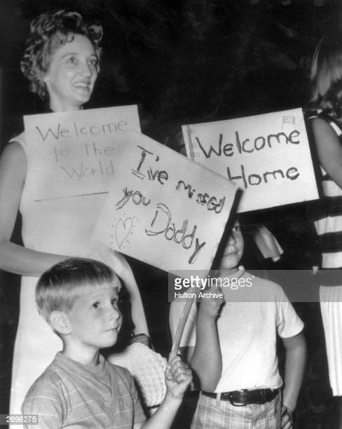 A woman and her young sons holding signs welcoming home returning soldiers from the Vietnam War at the 312th Medical Evacuation Hospital WinstonSalem...