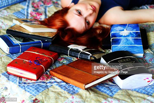 woman and journals - ginger lynn stock pictures, royalty-free photos & images