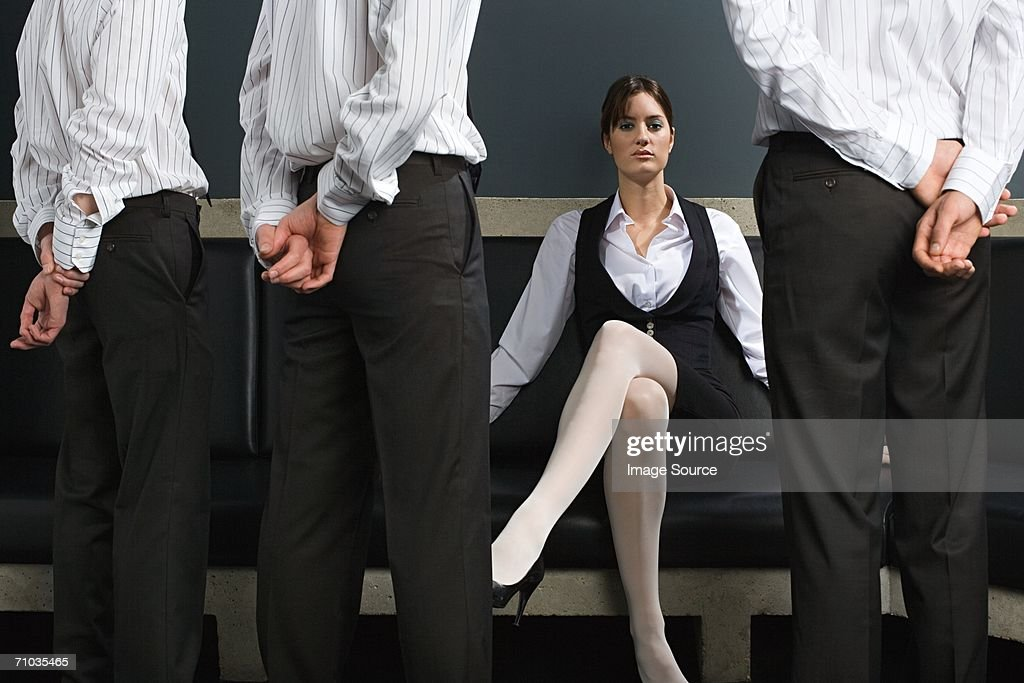 Woman and male employees : Stock Photo