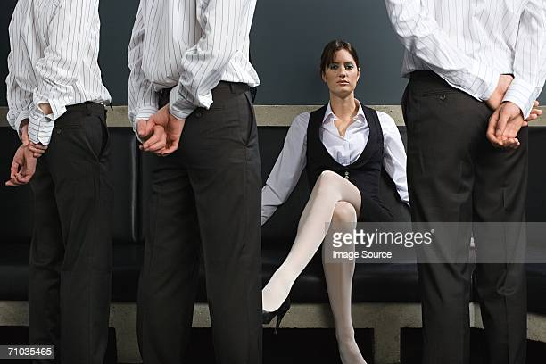 woman and male employees - women dominating men stock photos and pictures