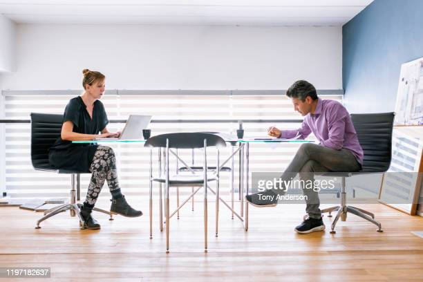 woman and man architects working together in their office - 様式 ストックフォトと画像