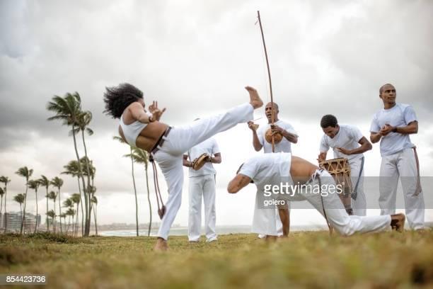 woman and man at capoeira roda in salvador da bahia - capoeira imagens e fotografias de stock