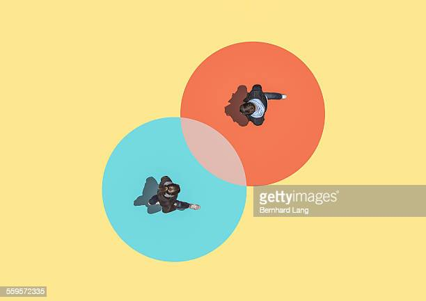 woman and man crossing, aerial view - circle stock pictures, royalty-free photos & images