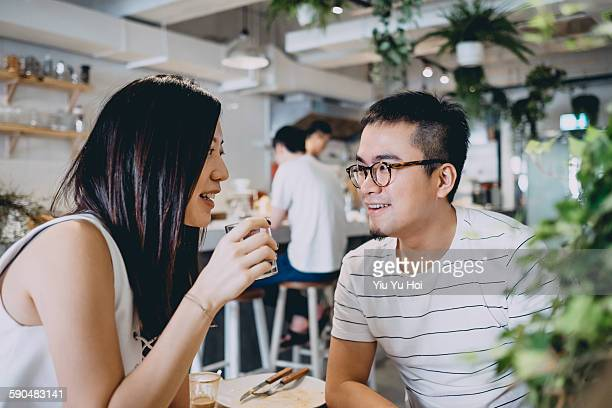 Woman and man having coffee and meal in restaurant
