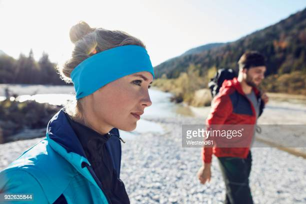 woman and man hiking at the riverside - headband stock pictures, royalty-free photos & images
