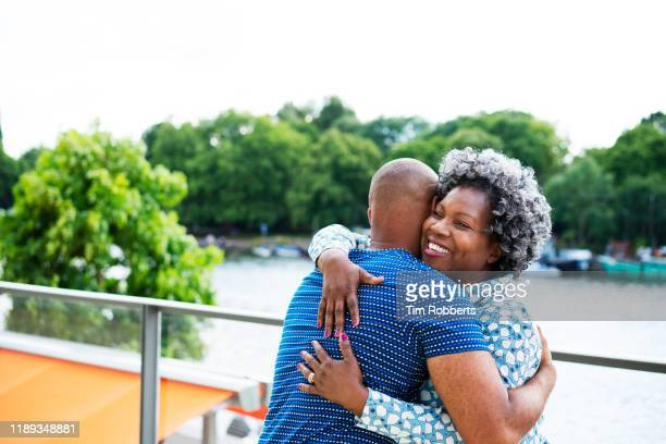 woman and man hugging - parenting stock pictures, royalty-free photos & images