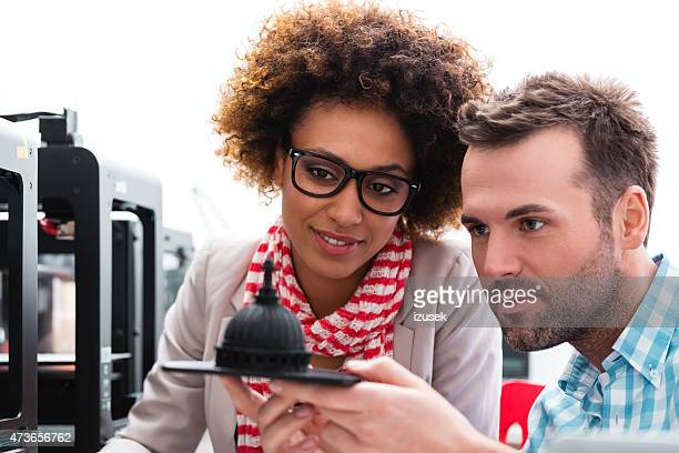 Woman and man in 3D printer office