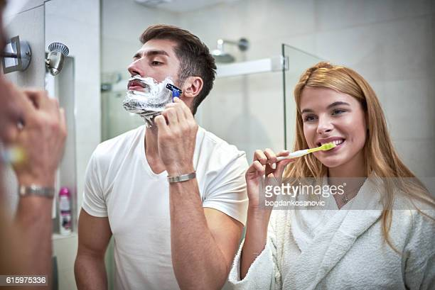Woman and man in bathroom