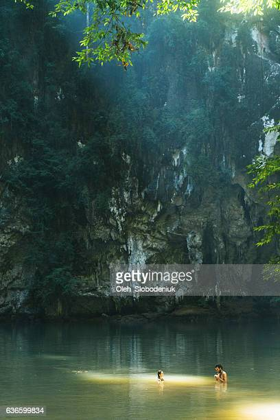 Woman and man in  lagoon in the jungles