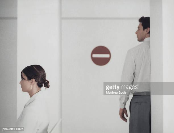 woman and man in office with do not enter sign - restraining stock photos and pictures