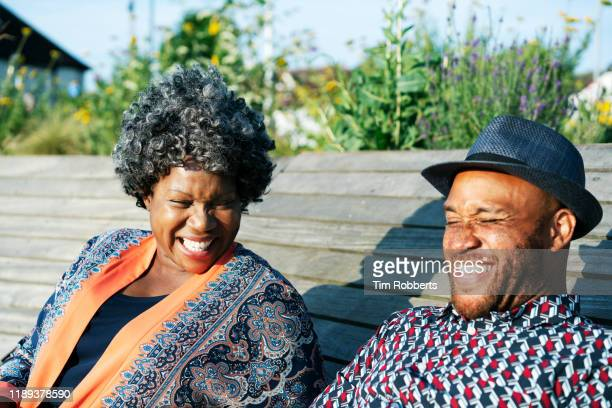 woman and man laughing together - son stock pictures, royalty-free photos & images