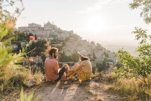 Woman and man looking at scenic view  of Gordes village in Provence 1040906722