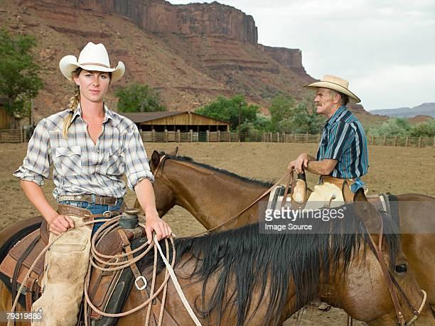 Woman and man on horseback