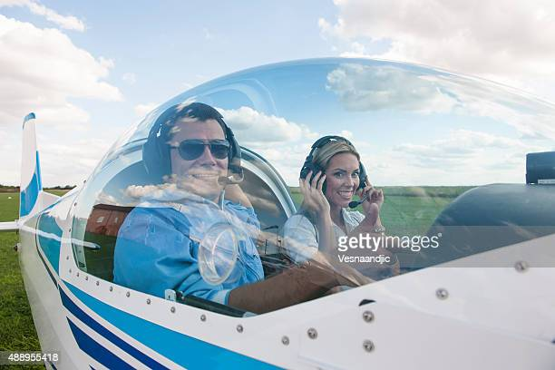 woman and man pilot looking at camera, preparing for flying - piloting stock pictures, royalty-free photos & images