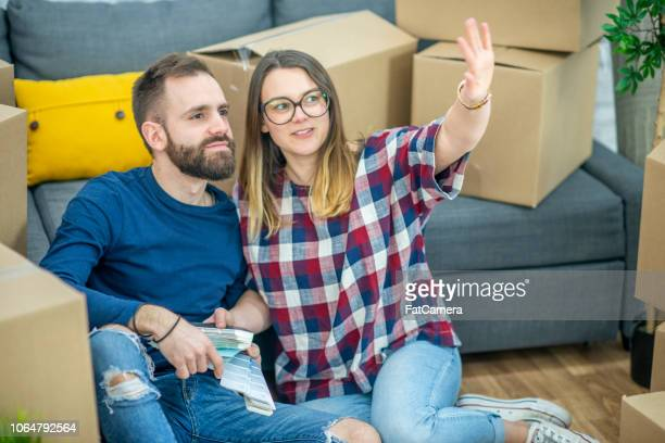 woman and man planning for new house - fatcamera stock pictures, royalty-free photos & images