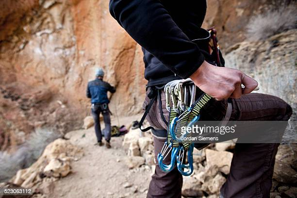 woman and man preparing to rock climb - chalk bag stock pictures, royalty-free photos & images