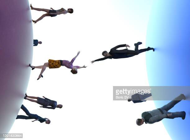 woman and man reaching to each other from different planets - stranger stock pictures, royalty-free photos & images