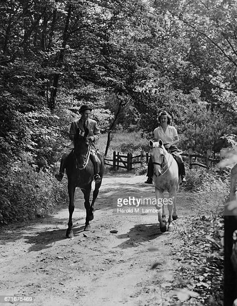 woman and man riding horse  - {{relatedsearchurl(carousel.phrase)}} stock pictures, royalty-free photos & images