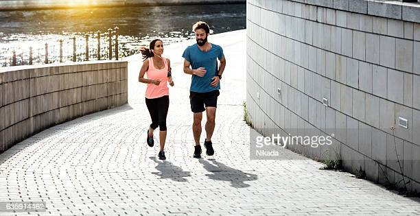 woman and man running together