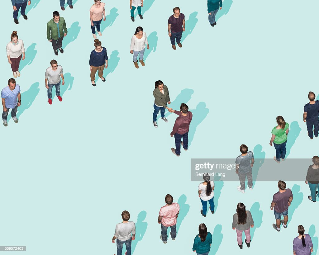 Woman and man shaking hands, Aerial View : Stock Photo