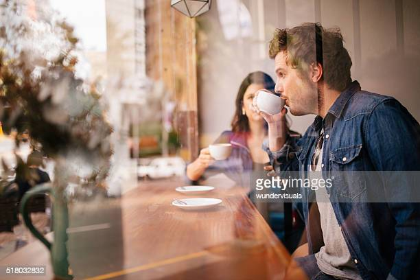 woman and man sitting coffee shop in case - stranger stock pictures, royalty-free photos & images