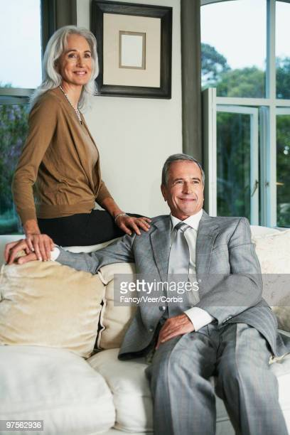 Woman and man smiling in living room