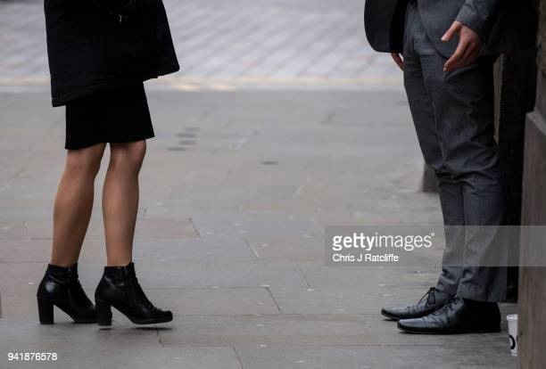 A woman and man talk in the street as the deadline nears for companies to report their gender pay gap on April 4 2018 in London England The British...