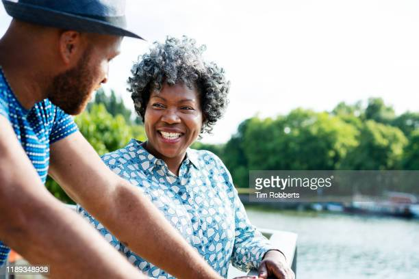 woman and man talking and smiling together - lifestyles stock pictures, royalty-free photos & images