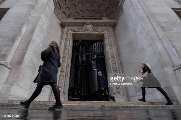 A woman and man walk into the Lloyds building as the deadline nears for companies to report their gender pay gap on April 4 2018 in London England...