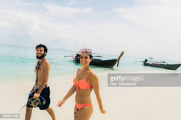 Woman and man walking on the beach