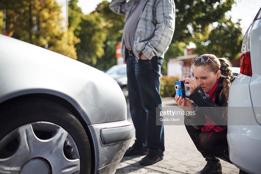 Woman and man with car : Stock Photo