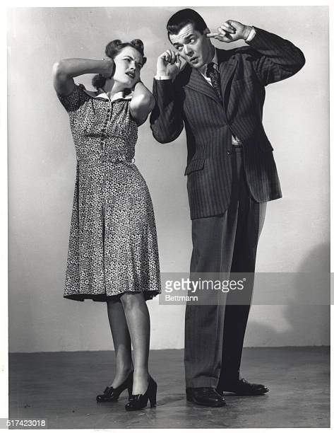 Woman and man with their hands over their ears Models S Honiss and Patricia Garfield Undated photograph BPA2# 4635 Gendreau Collection