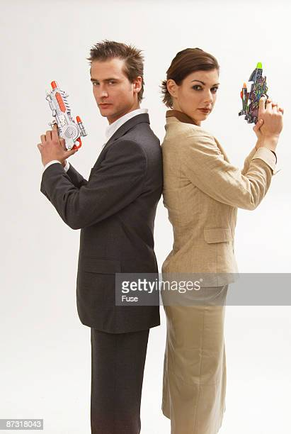 Woman and man with toy pistols