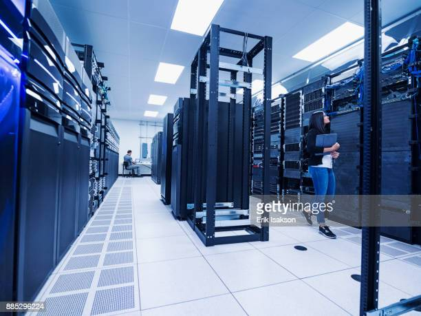 woman and man working in server room - data center stock pictures, royalty-free photos & images