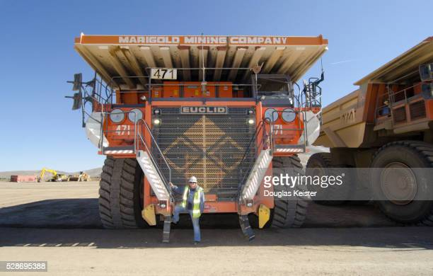 Woman and Monster Mining Truck at Gold Mine in Nevada