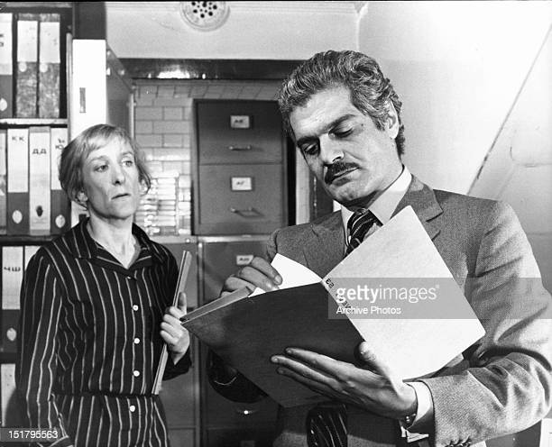Woman and Omar Sharif together in a scene from the film 'The Tamarind Seed', 1974.