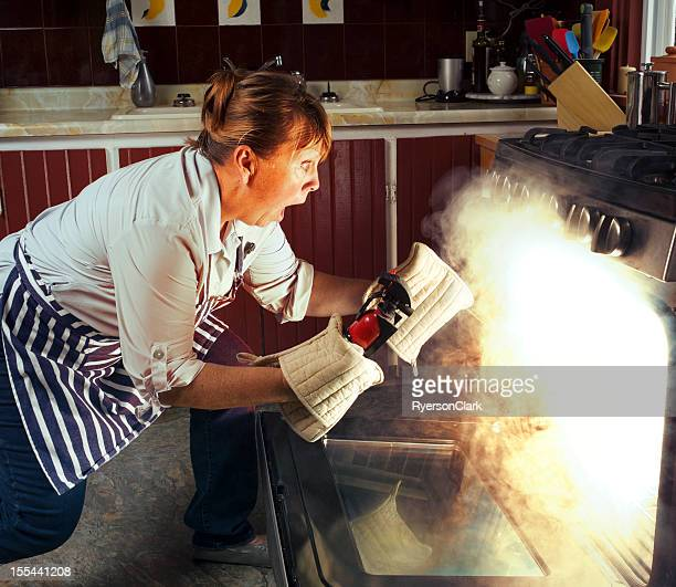 Woman and Oven Fire While Cooking in the Kitchen