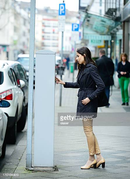 woman and parking meter - parking meter stock photos and pictures
