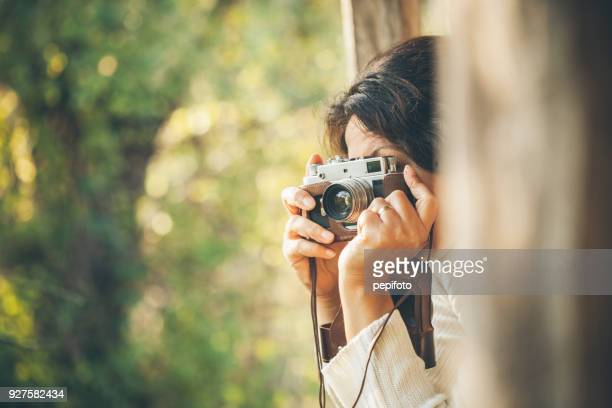 woman and retro camera - photography themes stock pictures, royalty-free photos & images