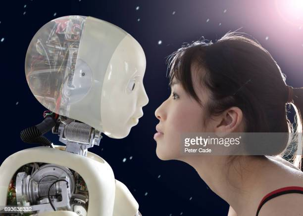 Woman and robot face to face